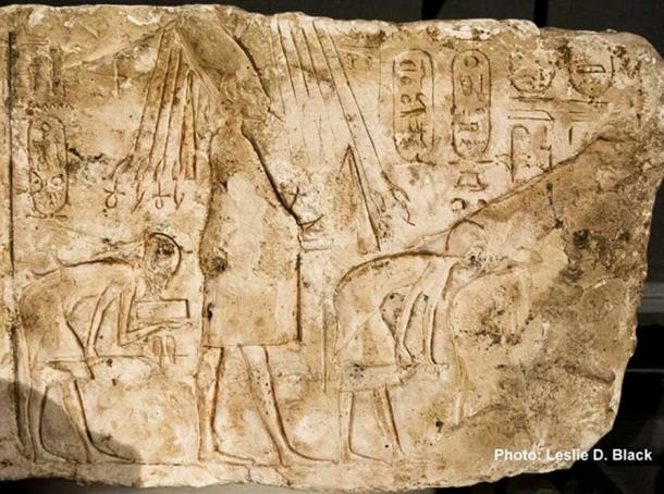 A limestone talatat block depicts Akhenaten celebrating the Heb Sed festival dressed in a jubilee outfit. The Aten's rays terminate in Ankh and Was signs—traditional symbols connoting life and dominion. The King holds the crook and flail in his hands; and is accompanied by bowing priests. Fitzwilliam Museum. Cambridge.