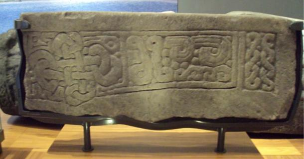 Tenth-century or later lintel stone fragment showing a cross-shaped knot inspired by the carving styles of Viking England. Now in the Kelvingrove Art Gallery and Museum, Glasgow, Scotland