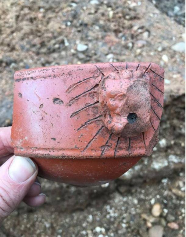 A lion-head spout from a Roman Samian ware mortarium (mixing bowl), late 2nd century AD, found during the excavation.