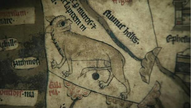 A lynx depicted on the Hereford Mappa Mundi, with sharp teeth and claws.