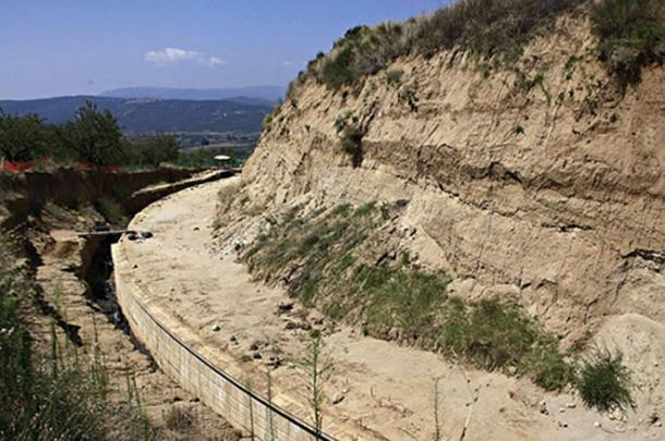 A marble wall surrounds the enormous Kasta Hill burial mound in Amphipolis