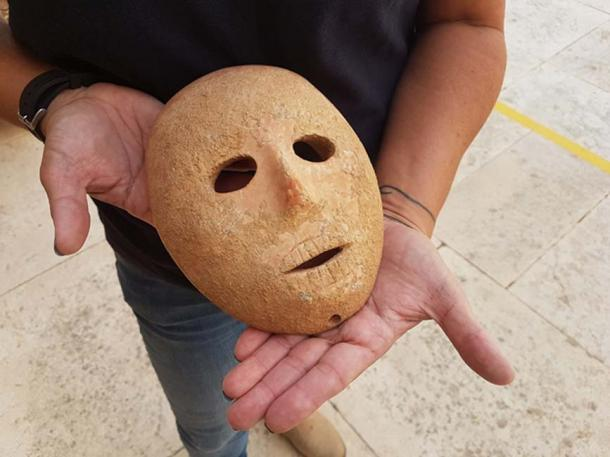 The mask dates to the Neolithic period, 9,000 years ago. (Israeli Antiquities Authority)