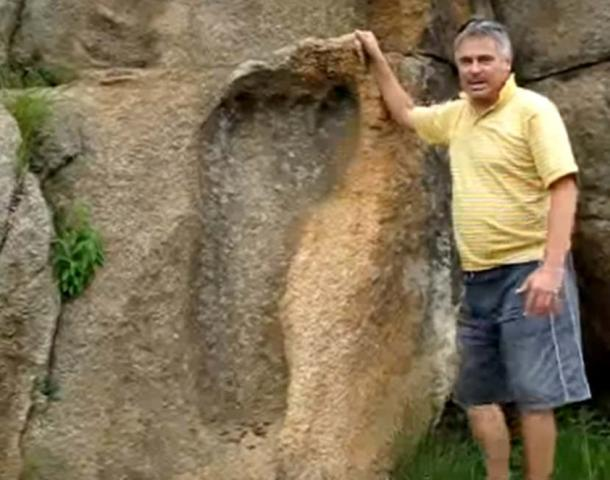 Michael Tellinger with the massive footprint in the rock in Africa
