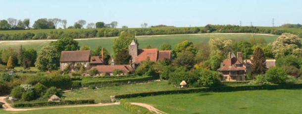 A view across the meadows to Luddesdown Church , with Luddesdown Court on the left, and Court Lodge on the right