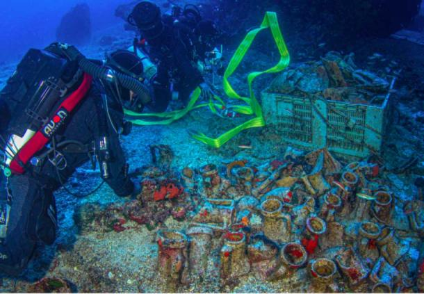 Members of the Coast Guard Submarine Disaster Unit Special Dive Team examine and recover many objects at the Antikythera Wreck. (Greek Ministry of Culture)
