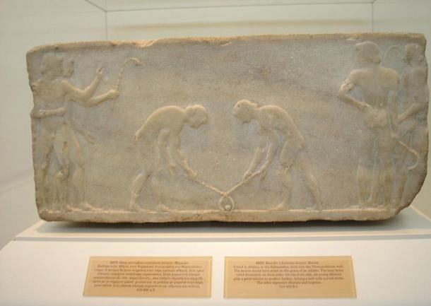 Bas relief approx. 600 BC, Kerameikos, Athens, shows men with hooked clubs or sticks playing with a ball. These ancient ball-and-stick games morphed into field hockey, ice hockey, and golf.