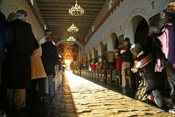 The 2007 midwinter solstice illumination of the main altar tabernacle of Old Mission San Juan Bautista, California. Rubén G.
