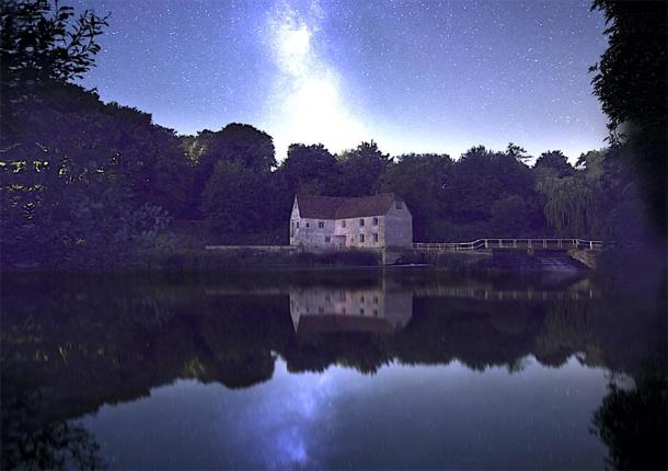 The ancient mill at night with stars in the sky. (Oliver Taylor / Adobe stock)