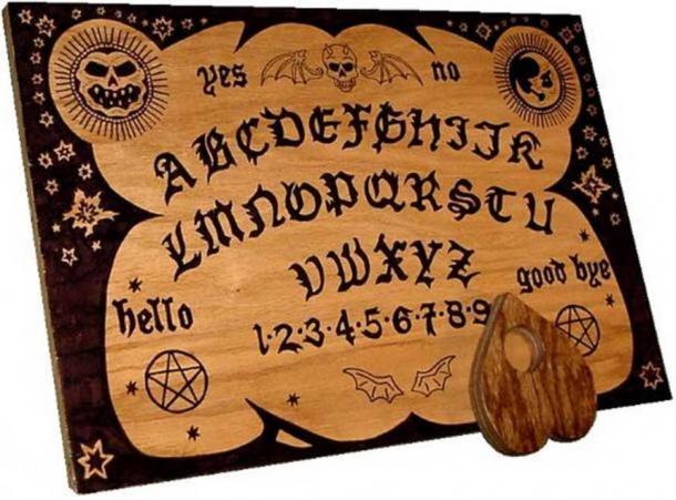 A modern Ouija board plus planchette.