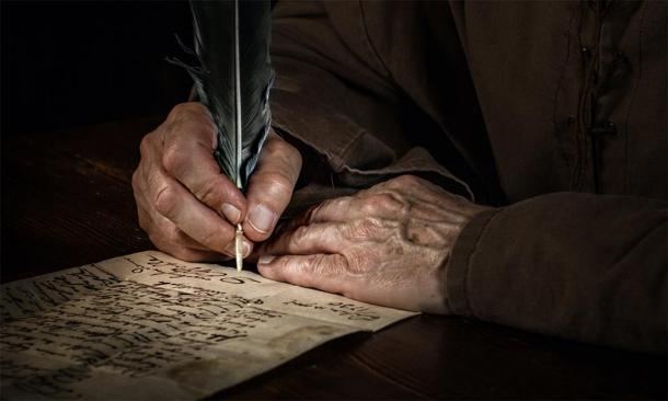A monk scribing an ancient language. (Thomas Mucha / Adobe stock)