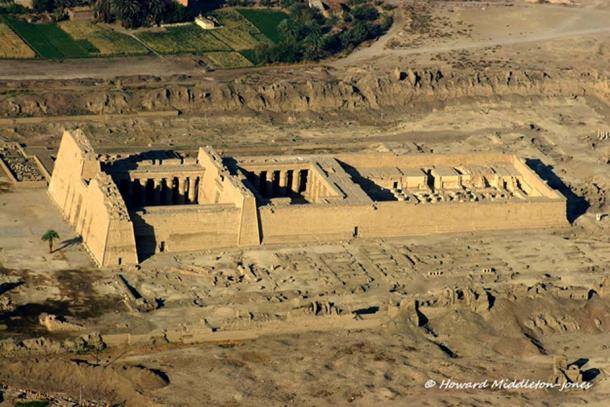 The imposing mortuary temple of Ramesses III at Medinet Habu. This place functioned as a workshop for rewrapping many royal mummies during the official 'restoration' project. The image was shot by the photographer during an aerial survey of the West Bank in 2010.