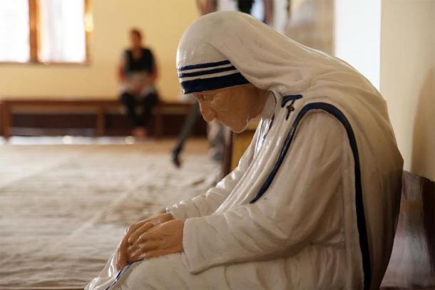 Statue of Mother Teresa in the chapel of the Mother House, Kolkata, India. The statue was made in the pose in which the Mother prayed. (zatletic /Adobe Stock)