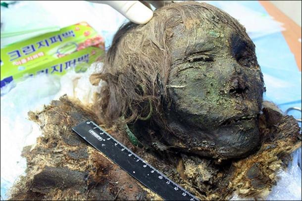 A cocoon with a mummy of an adult was covered with copper plates head to toe. Picture: Alexander Gusev