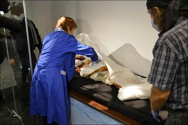 The mummy is getting inside a sarcophagus of Anokhin museum, Gorno-Altaisk, under a watchful eye of Irina Salnikova, head of the Siberian Branch of Russian Academy of Sciences Museum of Archeology and Ethnography.