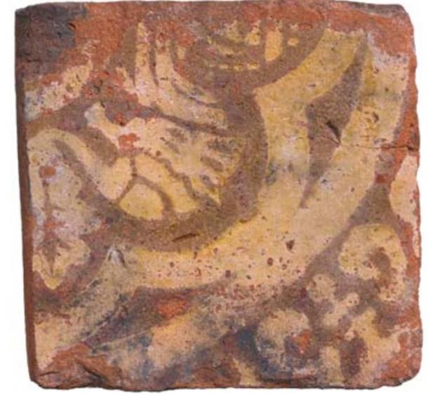 The tile of the mythical beast found at the cesspit site. (MOLA)