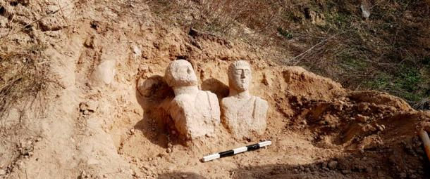 The newly-discovered Roman busts in-situ.