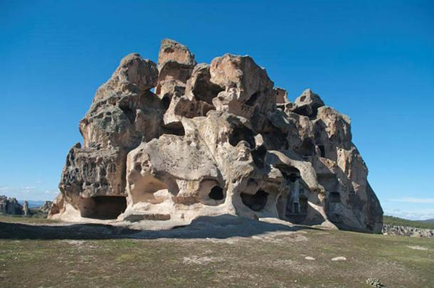"""A northeastern side view of a rock-cut necropolis with several Phrygian tombs which lies to the south of the Midas Monument in Yazılıkaya (lit. """"inscribed rock"""" in Turkish) village, Eskişehir - Turkey."""