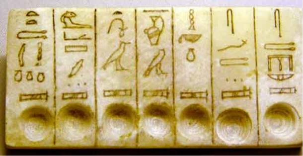 An offering tablet of the seven sacred oils (this object was not found in the tombs but shows the hieroglyphics for the names of the oils).