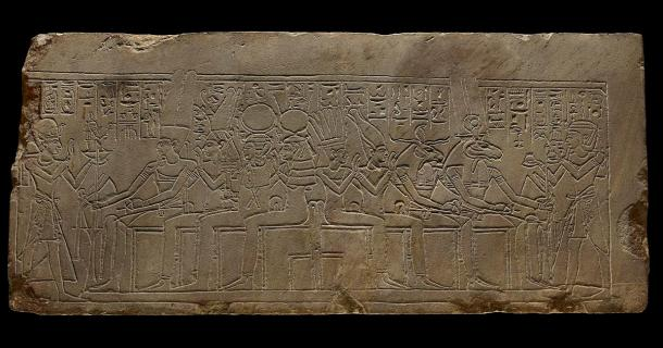 On the right of this image you see King Amenhotep I making an offering of ointment jars to Amen-Re' (here depicted as having a ram's head), Khnum, Satet and Anuket who are all enthroned behind a similar altar. (Trustees of the British Museum/CC BY NC SA 4.0)