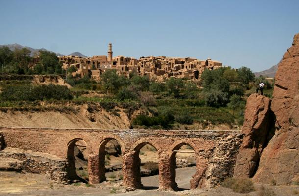 The old bridge of Kharanaq, with the Old Town in the background.