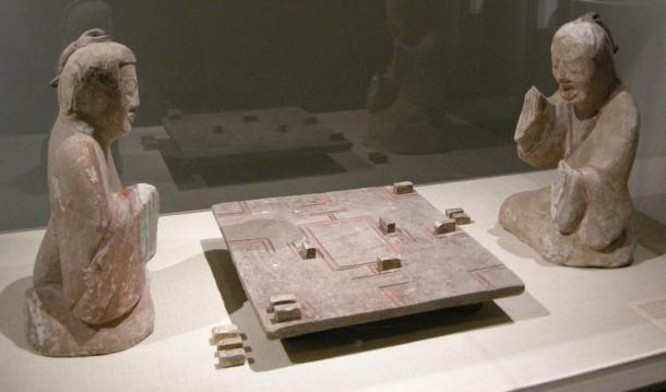 A pair of Eastern Han Dynasty (25–220 CE) ceramic tomb figurines of two gentlemen playing liubo.