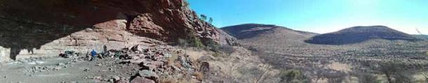 The archaeological site at a rock shelter in South Africa's Kalahari Desert. More than 100,000 years ago, people used the so-called Ga-Mohana Hill North Rockshelter for spiritual activities. (Credit: Jayne Wilkins)