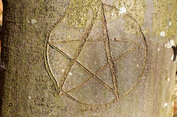A pentagram image was found on the body.