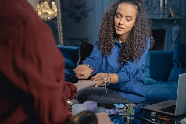 Today, many people see a tarot reader as a form of therapy. Credit: Viacheslav Iakobchuk / Adobe Stock