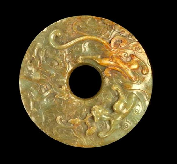 Example of a perforated jade disc (Bi) with Dragons.