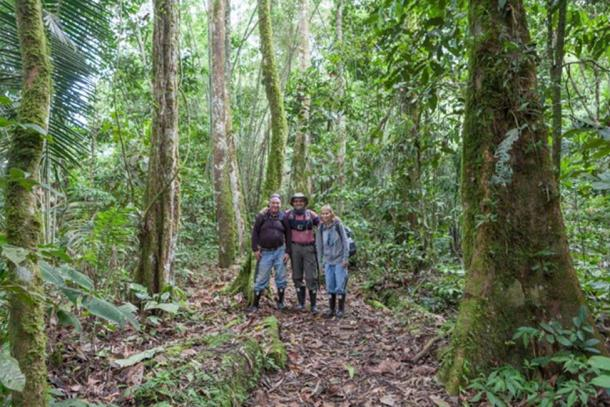 Scott, John and Wendy break from hiking to snap a photo in the rainforest.