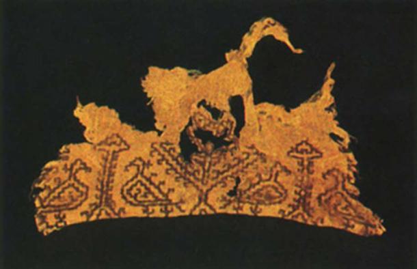 A piece of textile found in 'Asi-al-Hadath Grotto. Courtesy of The Groupe d'Etudes et de Recherches Souterraines du Liban. (1990)