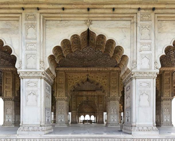 The pillars and interior of Diwan-i-Khas in historic Red Fort. The once-silver ceiling has been restored in wood. (Zoran Karapancev / Adobe Stock)
