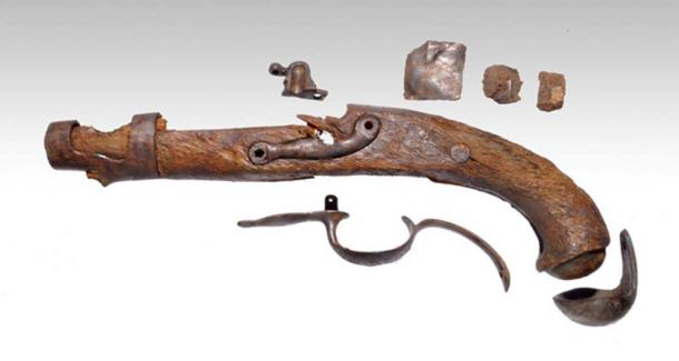 A pistol underwater archaeologists found aboard the ship Mentor.