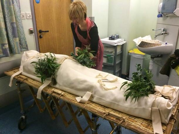 Some people today still like to place rosemary and other herbs on a deceased body (shrouds4all)
