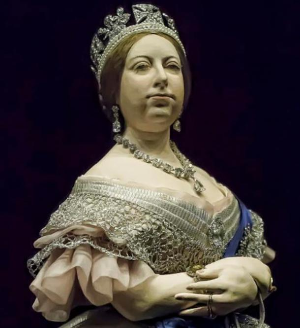 Detail of a portrait sculpture of Queen Victoria of England by George Stuart shown wearing the Koh-I-Noor Diamond in a brooch.