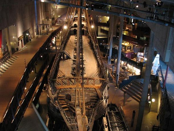The preserved Vasa in the main hall of Vasa Museum seen from above the bow.