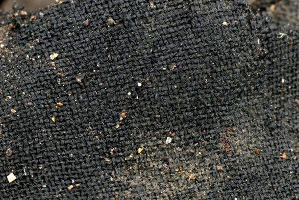 This photo may not look like much, but it is a fantastically preserved specimen of a 3,000-year-old textile piece from the Must Farm site. An expert says some of the textiles at the site are as fine as any of Europe at that time.