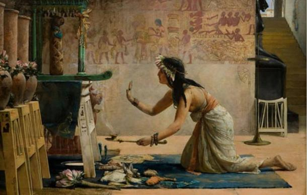 A priestess performing a ceremony. 'The Obsequies of an Egyptian Cat' by John Reinhard Weguelin.