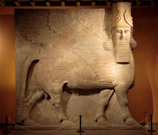 This protective spirit known as a lamassu is a composite being with the head of a human, the body and ears of a bull, and the wings of a bird. (Trjames / CC BY-SA 3.0)