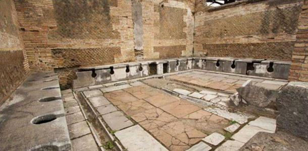 Example of the ruin of a second-century public toilet in Roman Ostia.