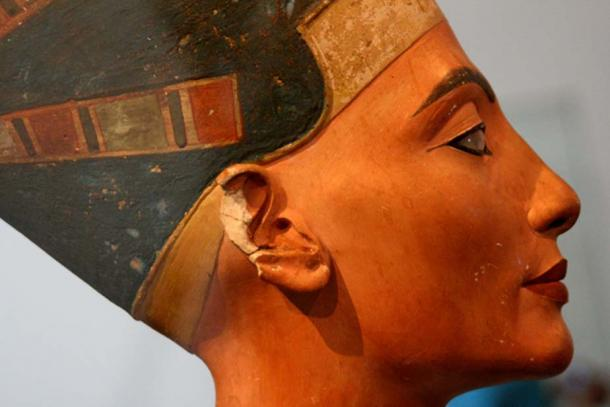 A bust of the ancient Egyptian queen Nefertiti, shown with kohl around here eyes.