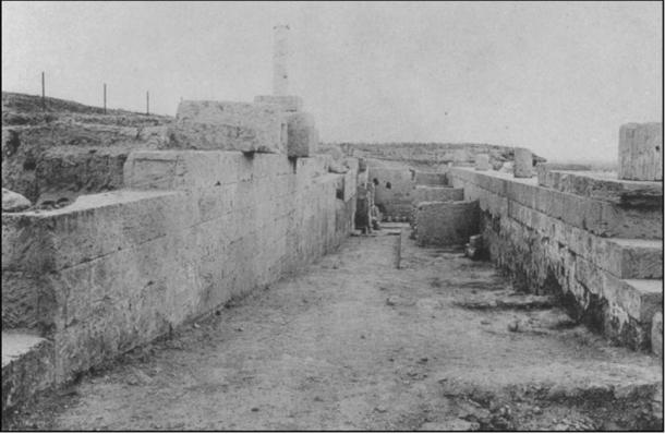 The ramp at the north side of the Sanctuary of Asklepios at Corinth, looking west towards the Lerna Court (Photograph taken with permission from Roebuck 1951: pl. 16.6 / Antiquity Publishers Ltd)