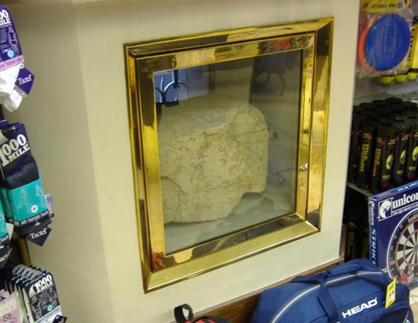 The rear of the London Stone, taken when the shop into whose wall it was set was used to sell sports equipment - an unusual juxtaposition of ancient and modern.