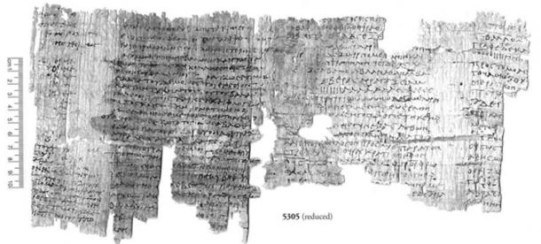 The recently translated papyrus containing magic spells.