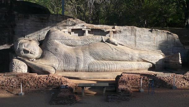 "An example of a reclining Buddha, also called a ""Nirvana Buddha,"" statue from the 12th century in Gal Vihara, Polonnaruwa, Sri Lanka."