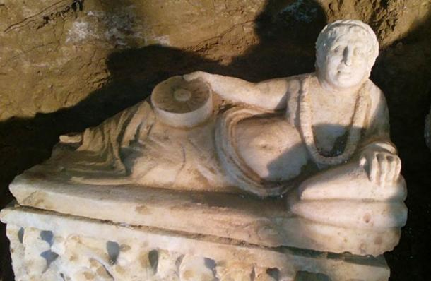 A reclining figure on the lid of one of the marble urns found in the tomb.