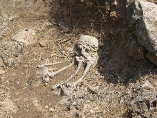 """A reconstruction of a Natufian burial at the """"El-Wad Terrace"""" archaeological site in the """"Nahal Me'arot"""" Nature Reserve, Israel."""