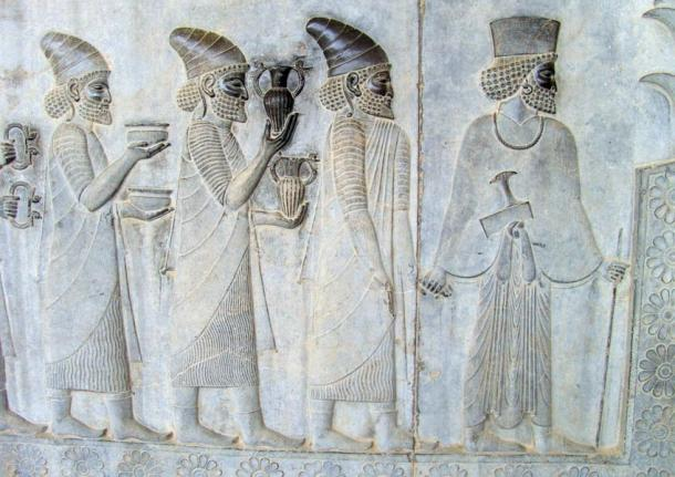 """Objects in the """"Apadana"""" reliefs at Persepolis: armlets, bowls, and amphorae with griffin handles are given as tribute."""