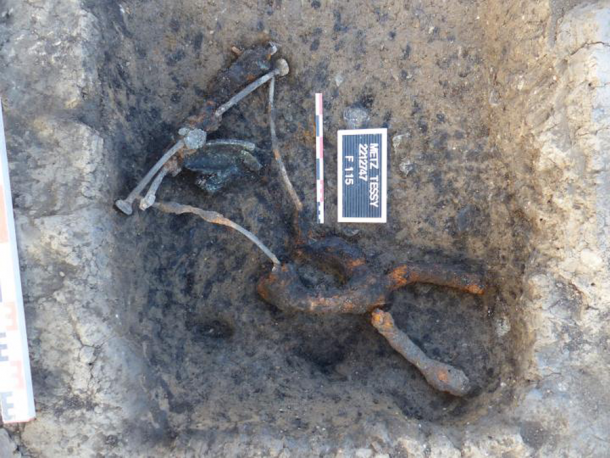 The metal remains of the recently found Roman curule chair as it was discovered. (©Emmanuel Ferber, INRAP)