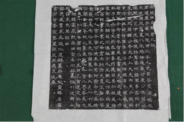 Amongst the remains found in the Chinese tomb was a fully legible epigraph. The ancient epigraph offers a written history of the life of the two occupants of the tomb, a couple by the name Qu Qing. (Zhou HuiYing / China Daily)